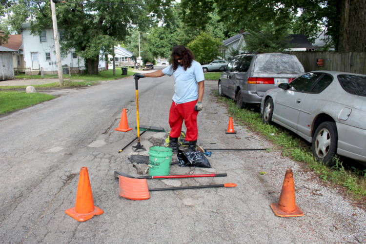 Michael Warren has spent about $400 out-of-pocket this summer to fill potholes in his Indianapolis neighborhood. (Annie Ropeik/IPB News)
