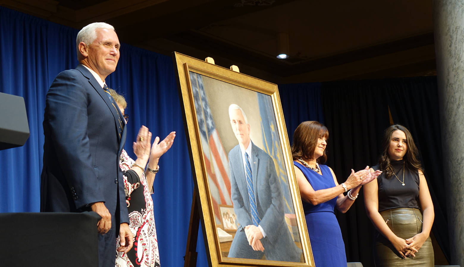 Vice President Mike Pence, his mother, wife Karen, and youngest daughter unveil his gubernatorial portrait. (Lauren Chapman/IPB News)