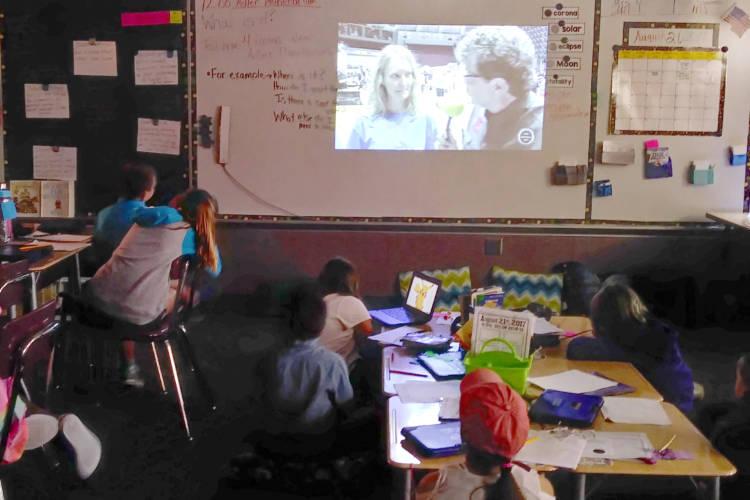 Wayne Township schools students watch a live stream lessons on the solar eclipse. (Lauren Chapman/IPB News)
