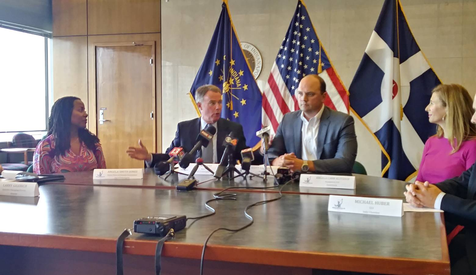 Indianapolis Mayor Joe Hogsett (second from left) discusses the region's proposal to Amazon. (Lauren Chapman/IPB News)