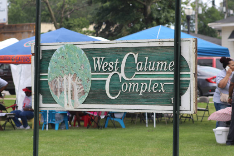 The closure of the West Calumet Housing Complex, its old sign seen here at a local block party in July, left a big hole in East Chicago's affordable housing stock that state officials now hope to help fill. (Annie Ropeik/IPB file photo)