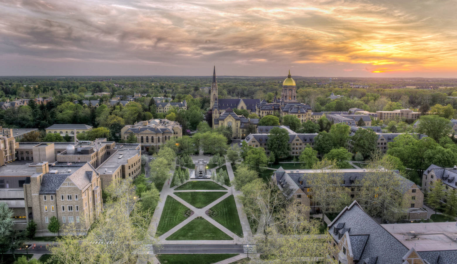 "The University of Notre Dame ranked No. 18 in U.S. News and World Report's 2018 ""Best Colleges"" list released Tuesday. Here the Basilica of the Sacred Heart and Golden Dome at sunset in 2013. (Credit: Barbara Johnston/University of Notre Dame)"