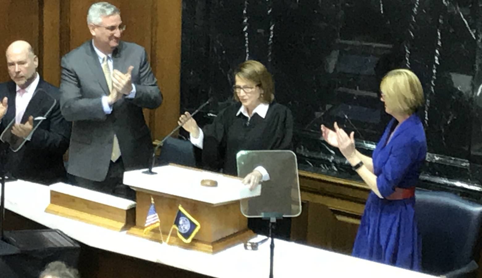 Gov. Eric Holcomb (left) and Lt. Gov. Suzanne Crouch (right) applaud Chief Justice Loretta Rush as she completes her State of the Judiciary address. (Brandon Smith/IPB News)
