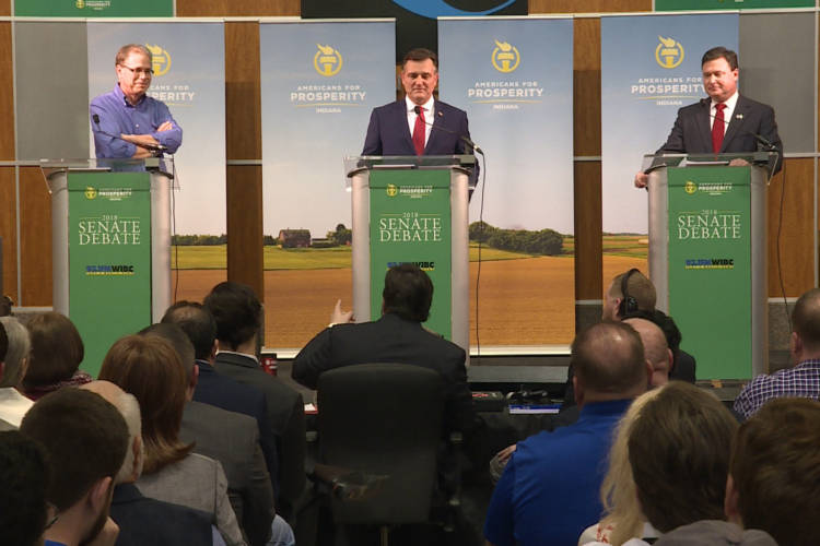Former state lawmaker Mike Braun, U.S. Rep. Luke Messer and U.S. Rep. Todd Rokita participate in a debate sponsored by by conservative group Americans for Prosperity-Indiana. (Barbara Brosher/WTIU)