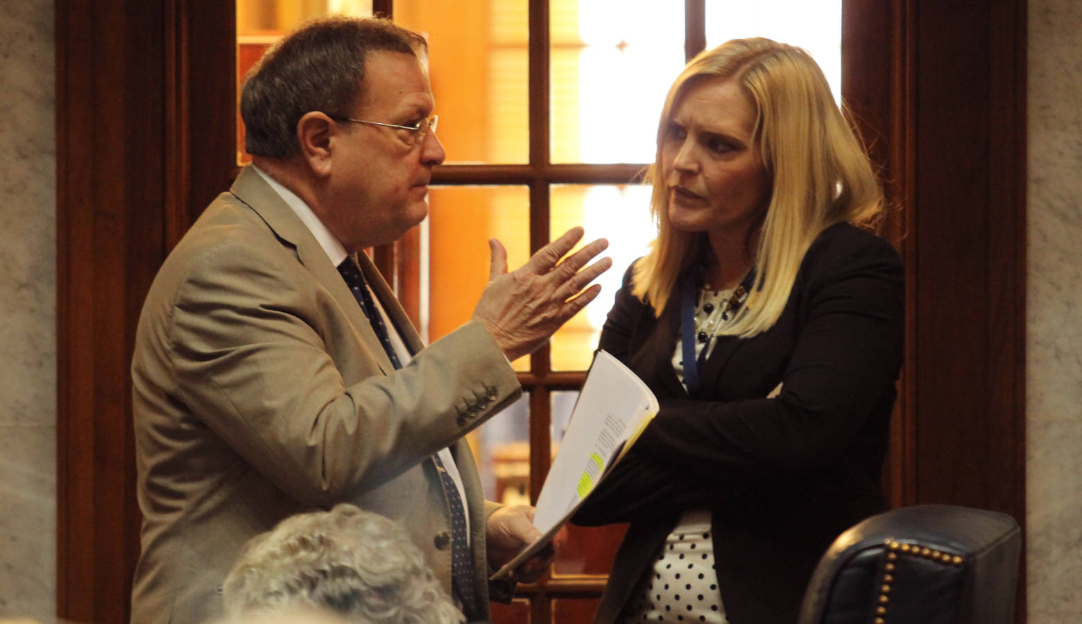 Sen. Erin Houchin (R-Salem), right, speaks to fellow Sen. Mike Young (R-Indianapolis) on the Senate floor. (Lauren Chapman/IPB News)