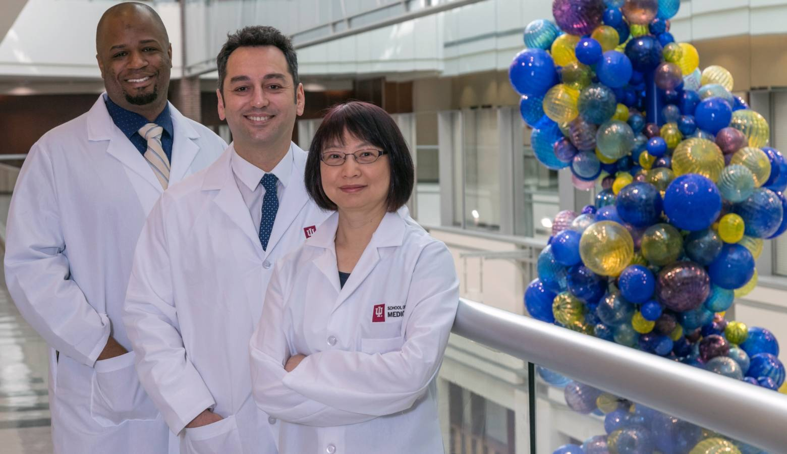 Indiana University School of Medicine Dr. Burcin Ekser (middle) and some of the team of researchers who work on organ transplant technology. (Photo courtesy Indiana University School of Medicine)