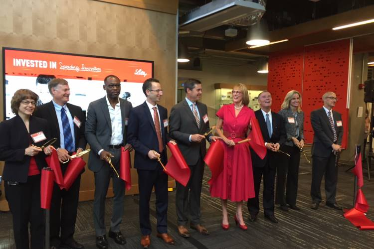 """Eli Lilly leaders join state and city officials for ribbon cutting at """"Building 302."""" (Jill Sheridan/IPB News)"""