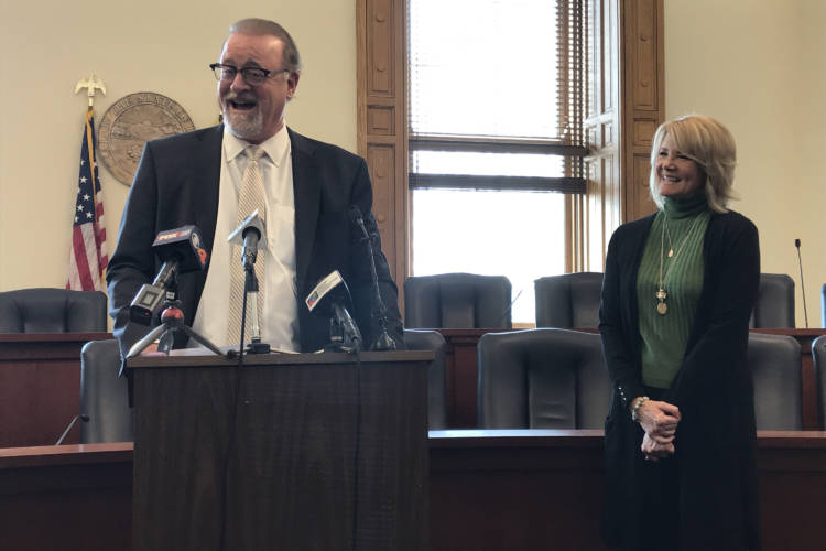 Sen. David Long (R-Fort Wayne), alongside his wife Melissa, announced his retirement at a press conference in February. It takes effect Nov. 6. (Brandon Smith/IPB News)