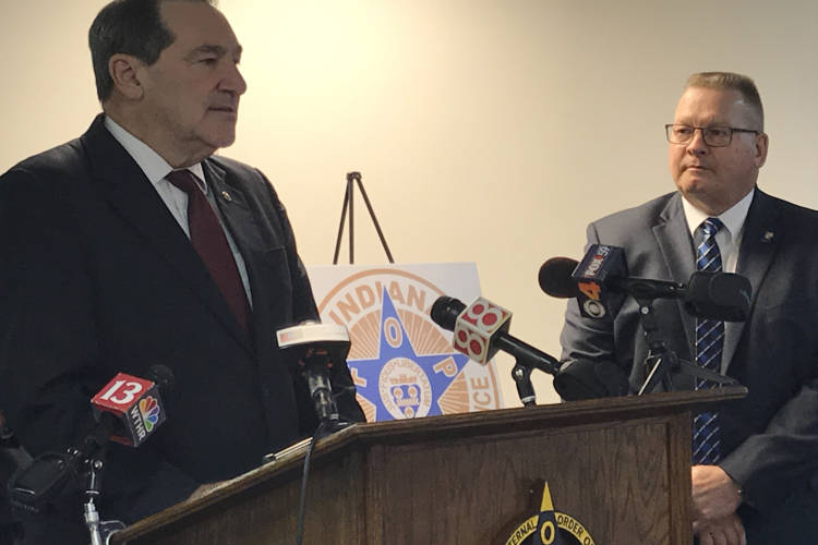 Sen. Joe Donnelly (D-Ind.), left, receives an endorsement from the Indiana Fraternal Order of Police and its president Bill Owensby, right. (Brandon Smith/IPB News)