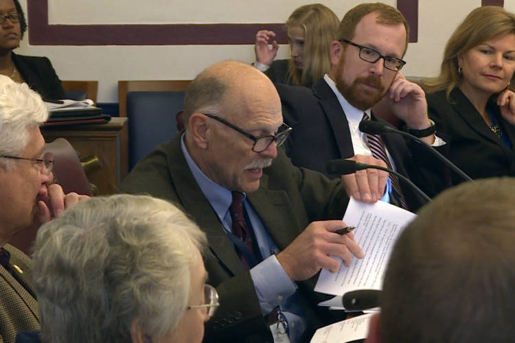 The Water Infrastructure Task Force makes last-minute changes to its report before finalizing it on Tuesday. (Rebecca Thiele/IPB News)