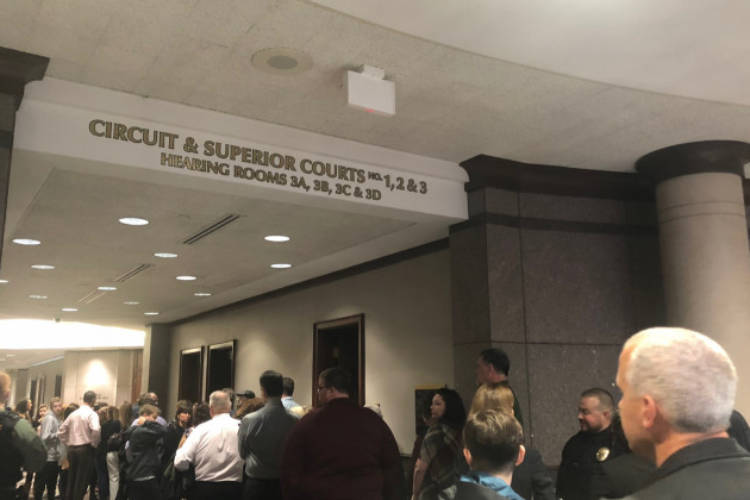 A line formed outside the Hamilton County Circuit Court Monday, Nov. 5. Not everyone got a seat in the courtroom for hearing of the juvenile accused of shooting classmate and teacher at Noblesville West Middle School.