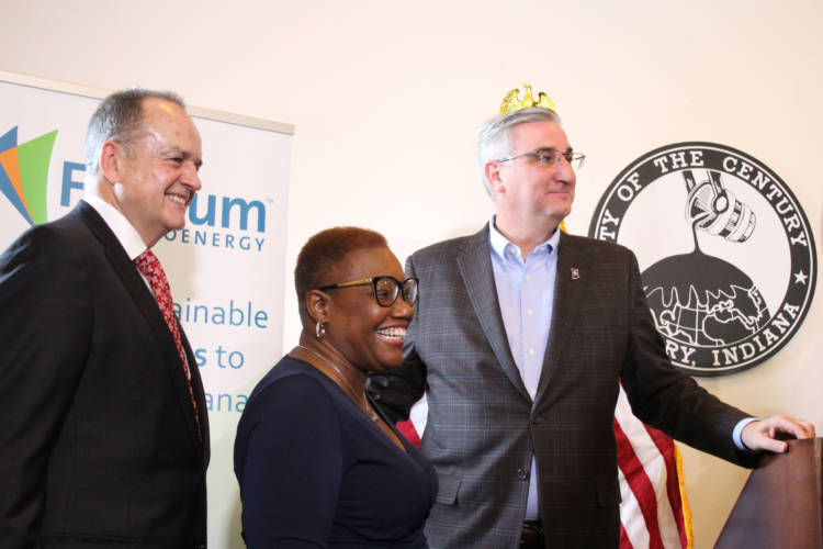 (Left to right) Fulcrum President and CEO Jim Macias, Gary Mayor Karen Freeman-Wilson, and Gov. Eric Holcomb celebrate Fulcrum's  announcement. (Samantha Horton/IPB News)
