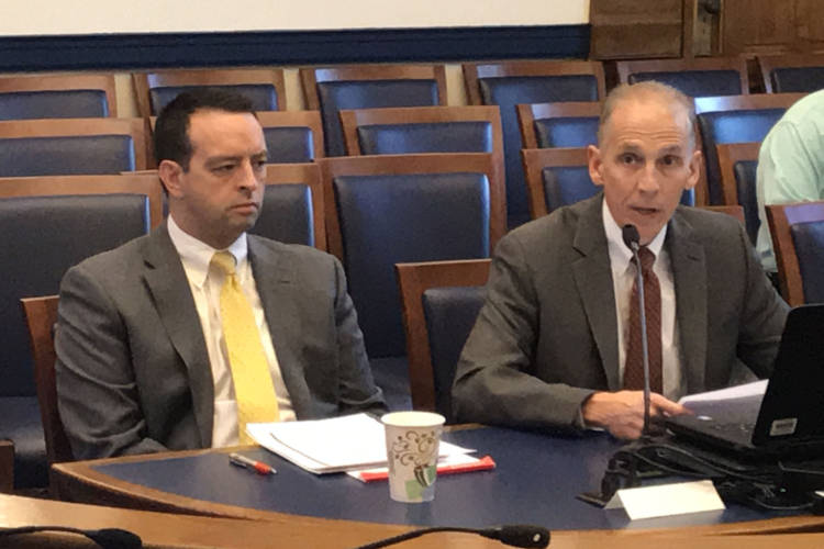 Office of Management and Budget Director Micah Vincent, left, and Indiana Finance Authority COO Jim McGoff discuss the Toll Road lease at the State Budget Commitee. (Brandon Smith/IPB News)