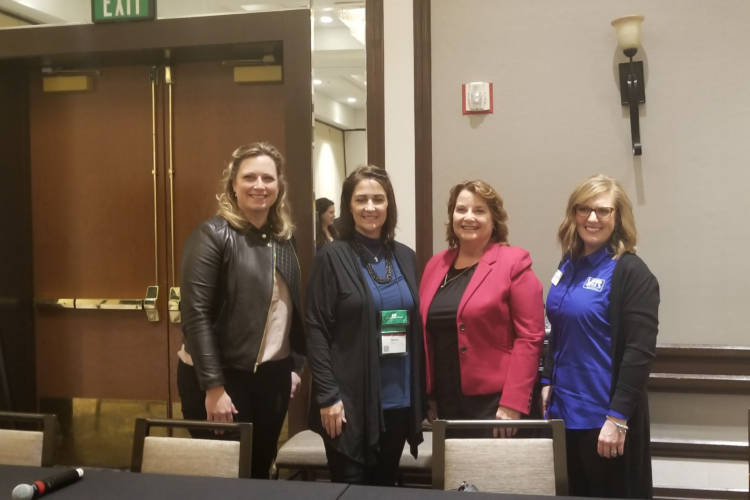 (Left to Right) Indiana farmers Leah Beyer, Susan Brocksmith, Joyce Kron and Kelly Whiteman Snipes discuss life as a women in the ag industry during a panel session at the Indiana Young Farmer and Ag Professionals Conference. (Samantha Horton/IPB News)