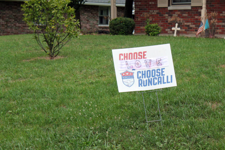 A sign from a house close to Roncalli High School protests the treatment of a guidance counselor. Shelly Fitzgerald's job has been threatened by the school over her marriage to a woman. (Lauren Chapman/IPB News)