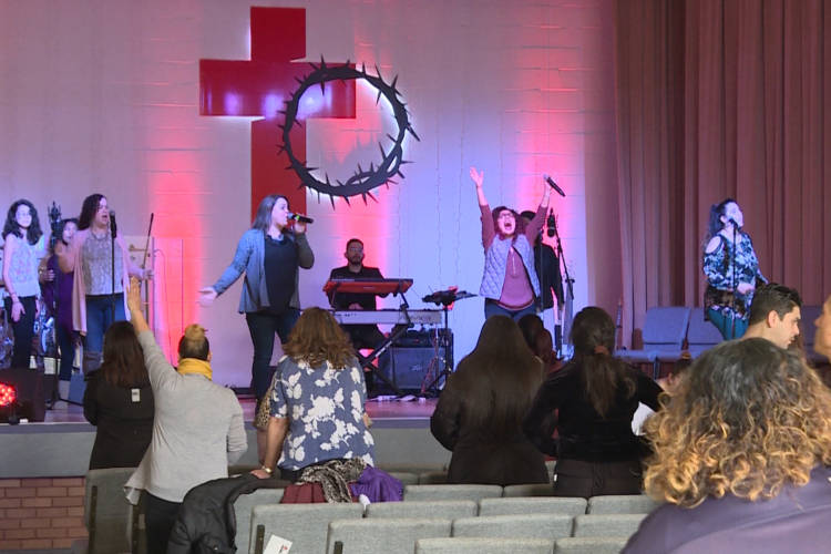 Members of The Cross Church — nondenominational, multicultural church in East Chicago — sing praise songs at one of their Sunday services. (Tyler Lake/WTIU)
