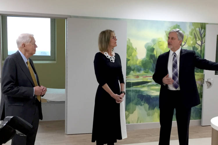Indiana's Drug Czar Jim McClelland and Lt. Gov. Suzanne Crouch receive a tour of the NeuroDiagnostic Institute. (Jill Sheridan/IPB News)