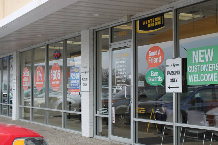 At the end of the legislative session's first half, a bill limiting payday lenders died, while another, allowing different types of high-interest loans, passed out of the Indiana Senate. (Lauren Chapman/IPB News)