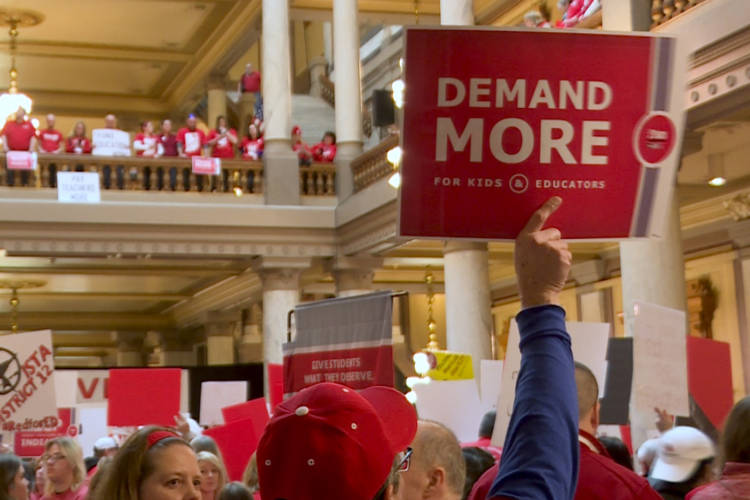 Attendees gathered on all three of the main floors of the statehouse to make their voices and concerns heard. (Jeanie Lindsay/IPB News)