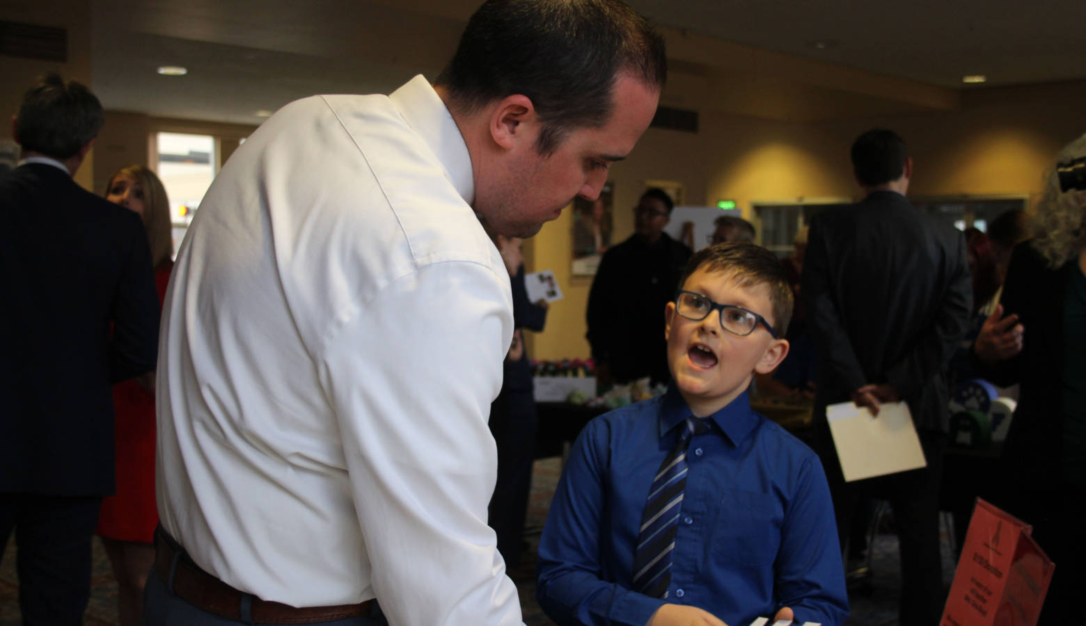 Mayflower Mill Elementary School third grader David Rowe explains his classroom's business to volunteer business judge First Merchants Bank Commercial Relationship Manager Vice President Greg Whited. (Samantha Horton/IPB News)