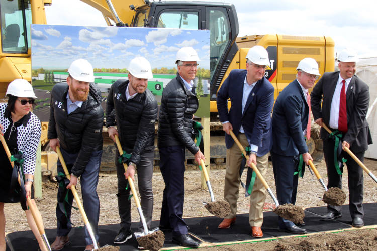 Gov. Eric Holcomb and to the left GreenLeaf President Dan Curtin break ground on the company's new production facility in Shelbyville. (Samantha Horton/IPB News)