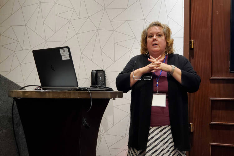 Fair Housing Center of Central Indiana executive director Amy Nelson presents at the annual Indiana Consortium of State and Local Human Rights Agencies Conference. (Samantha Horton/IPB News)