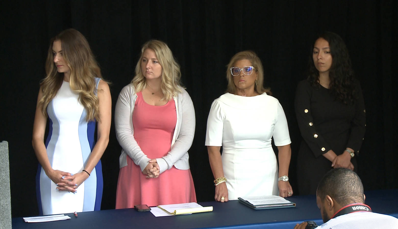 From left, Niki DaSilva, Gabrielle McLemore, Rep. Mara Candelaria Reardon (D-Munster) and Samantha Lozano at a press conference announcing they're suing Curtis Hill and the state of Indiana. (Zach Herndon/WTIU)