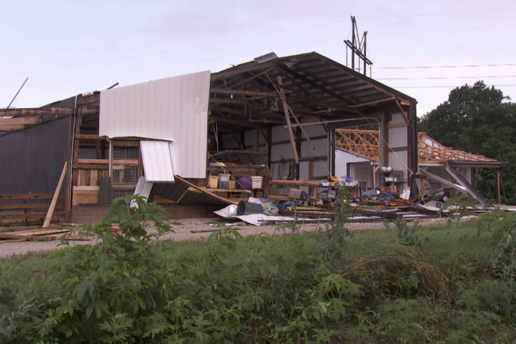 Like her home, Sue Stolz's barn was severely damaged in the tornado (Seth Tackett/WTIU)