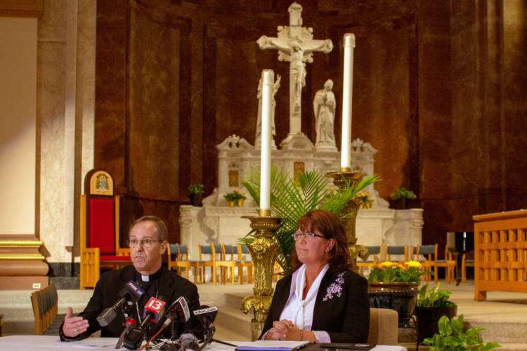 Archbishop Charles Thompson and Superintendent of Catholic Schools Gina Fleming defend the Archdiocese's policy on LGBTQ teachers at Catholics schools. (Evan Robbins/WFYI News)