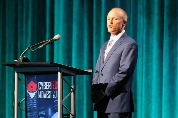 Rolls-Royce president of defense programs, Phil Burkholder, announces a new partnership with Purdue University to improve cybersecurity training at the Cybertech Midwest conference in Indianapolis. (Lauren Chapman/IPB News)