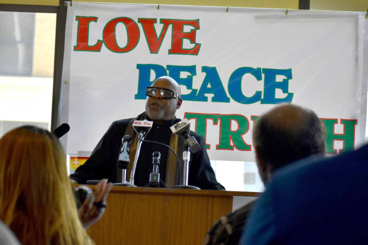 "Rev. Sylvester Williams speaking at an event where South Bend ministers prayed for the city to ""heal."" (Justin Hicks/IPB News)"