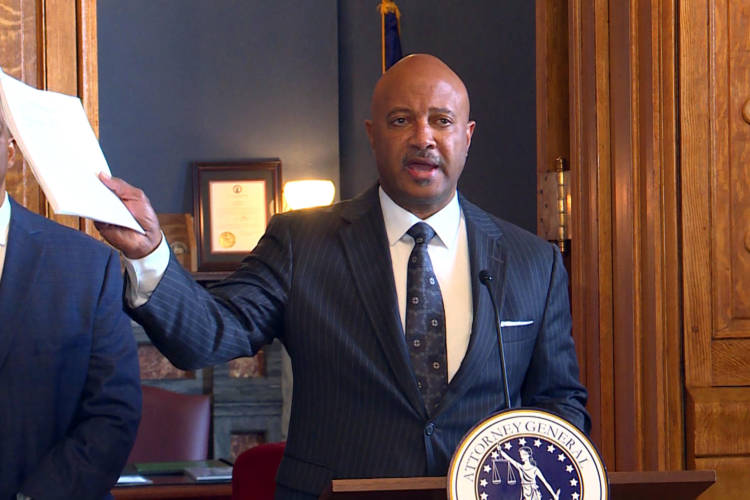 Attorney General Curtis Hill holds the 92 page complaint against opioid manufacturer Purdue Pharma during a November 2018 press conference. The recent decision in Oklahoma against Johnson & Johnson alleged similar complaints. (Lauren Chapman/IPB News)