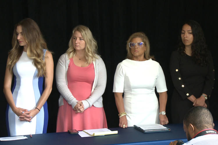 From left, Niki DaSilva, Gabrielle McLemore, Rep. Mara Candelaria Reardon (D-Munster) and Samantha Lozano at a press conference in June. (Brandon Smith/IPB News)