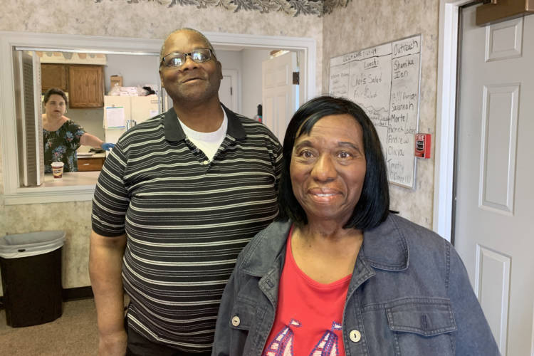 Clubhouse member David Fearance and his caregiver Kat Blane at Circle City Clubhouse. Fearance, a 59-year-old Army veteran has been coming to this converted office building on Indy's west side for nearly three years. (Jill Sheridan/IPB News)