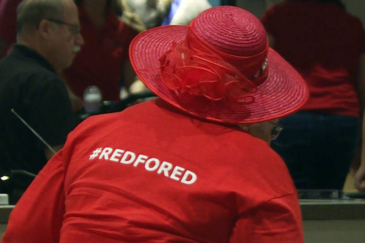"""Red for Ed"" has become a rallying cry among public educators as they press lawmakers to boost pay and better support public schools. (Jeanie Lindsay/IPB News)"