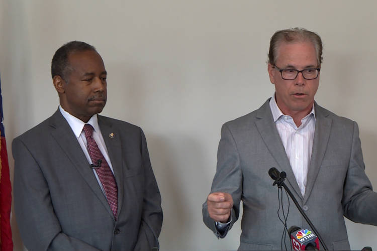HUD Secretary Ben Carson, left, and Sen. Mike Braun (R-Ind.) discuss opportunity zones in Indianapolis. (WTIU)