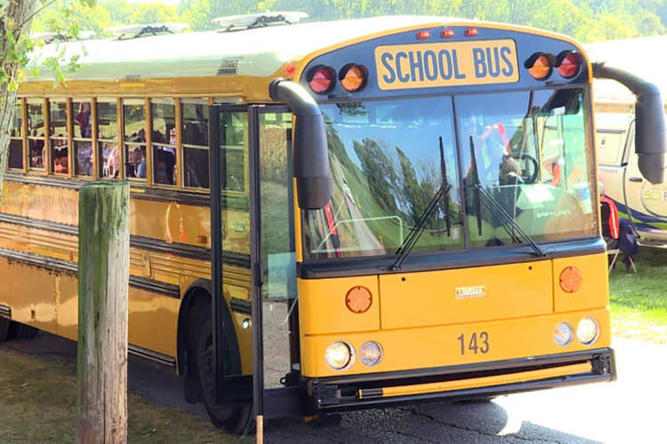 A law that went into effect earlier this year makes says drivers caught illegally passing stopped school buses can face penalties including fines of up to $5,000 or have their license suspended for up to a year. (Jeanie Lindsay/IPB News)