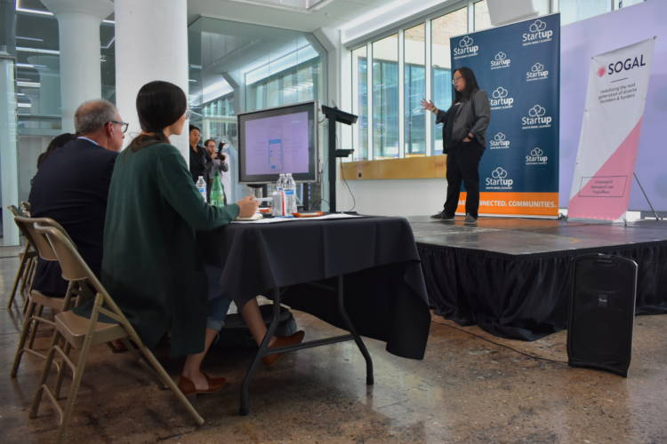 Daisy Pham of Halo App pitches her business concept of a phone application for small-dollar loans to a panel of venture capitalists. (Justin Hicks/IPB News)