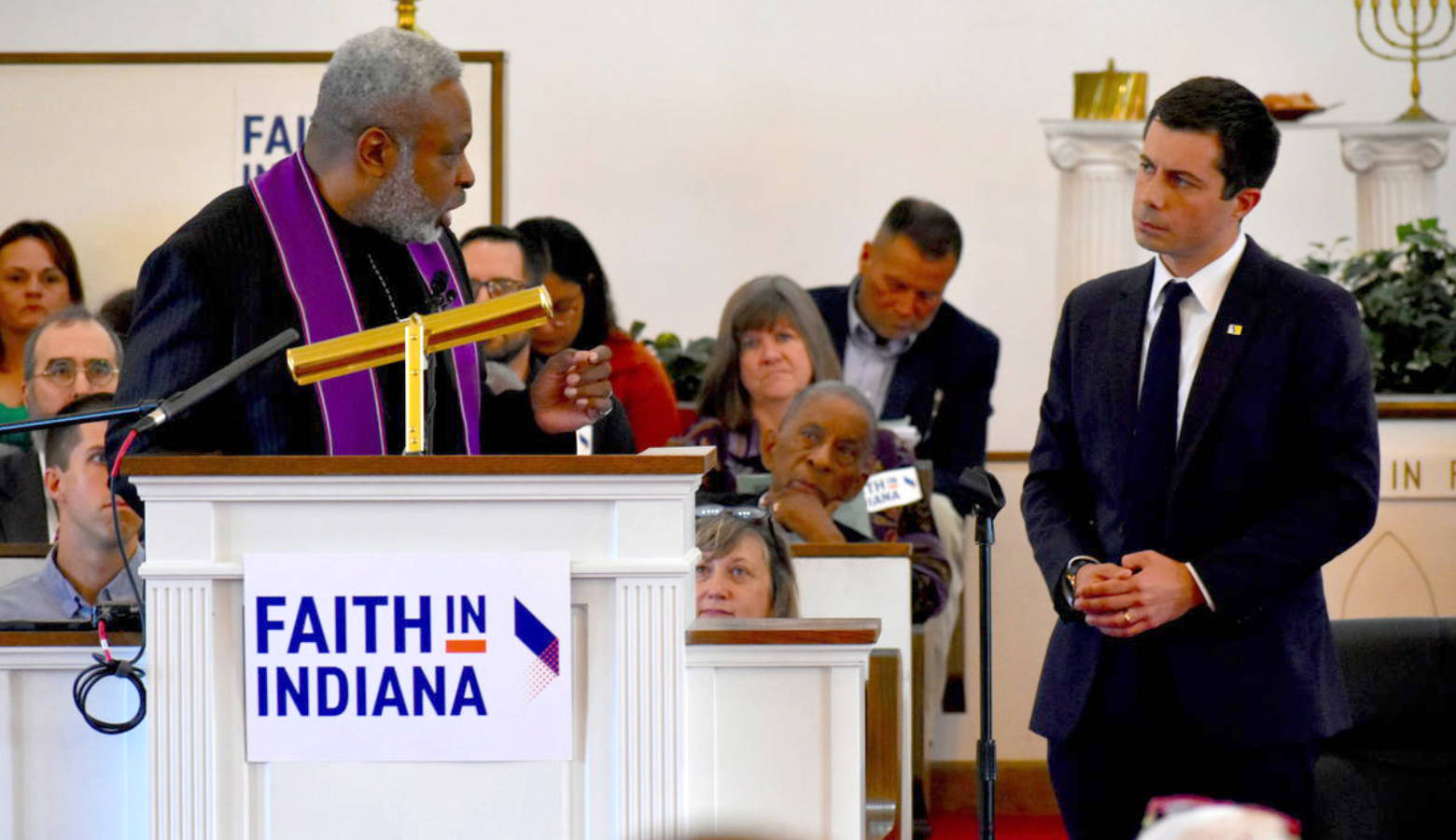 Rev. Gilbert Washington asks South Bend Mayor Pete Buttigieg questions on behalf of Faith in Indiana. (Justin Hicks/IPB News)
