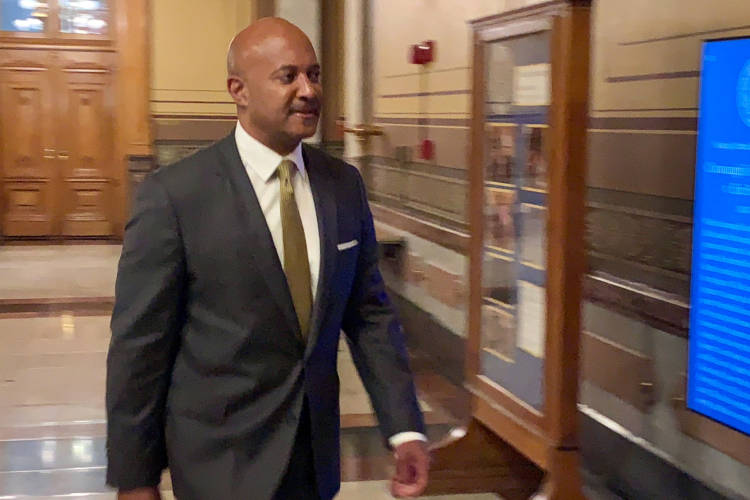 Attorney General Curtis Hill walks into the Indiana Supreme Court courtroom during the second day of his attorney disciplinary hearing. (Brandon Smith/IPB News)