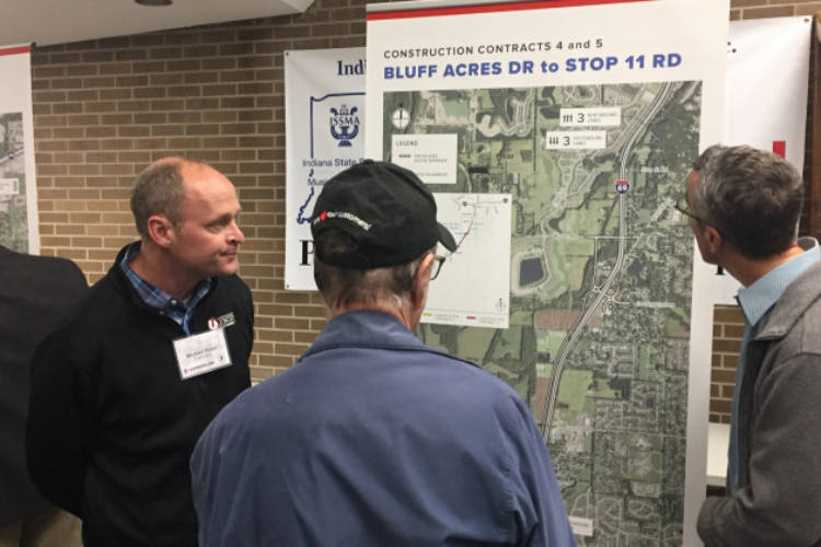 Local residents examine a map explaining changes part of the I-69 Section 6 project.