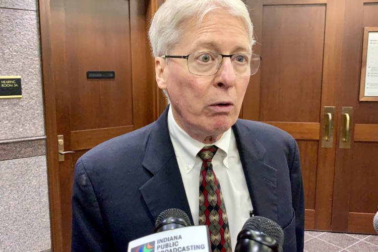 "Attorney Jim Bopp speaks to reporters after he asked a Hamilton County judge to strike down the so-called ""fix"" to Indiana's controversial Religious Freedom Restoration Act. (Brandon Smith/IPB News)"