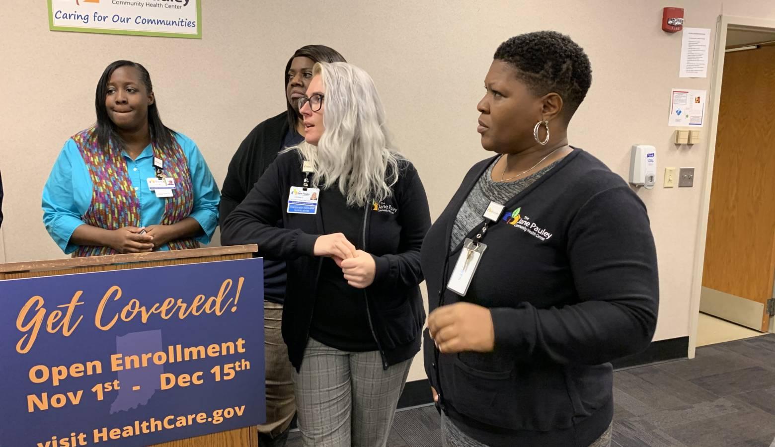 Employees from the Jane Pauley Community Health Center at an open enrollment visit. (Jill Sheridan/IPB News)
