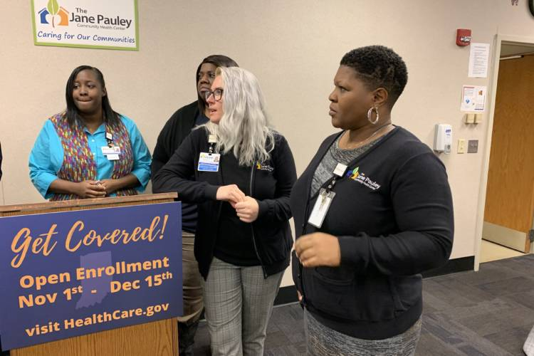 Employees from the Jane Pauley Community Health Center at an open enrollment visit. (Jill Sheridan/IPB News)
