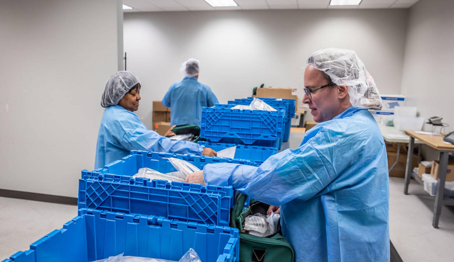 Workers at Bosma Enterprises with visual impairments packaging products. (Courtesy of Bosma Enterprises)