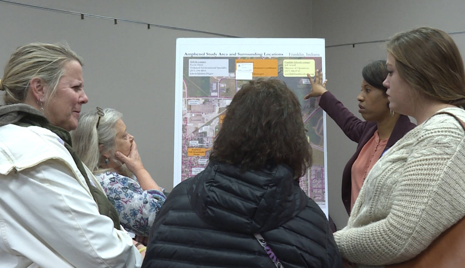 Franklin residents talk with officials at the Environmental Protection Agency about the contamination at an open house on Dec. 3. (Rebecca Thiele/IPB News)