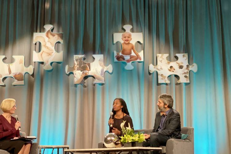 State Health Commissioner Kris Box discusses infant mortality with Dr. Nzinga Harrison and Dr. Dipesh Navsaria at the Labor of Love Summit Dec. 11. (Darian Benson/IPB News)