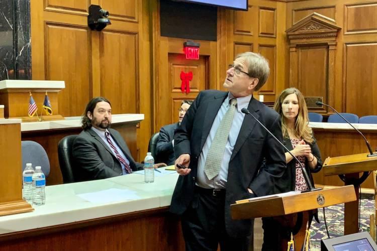 Attorney Bill Groth, center, discusses his election security presentation as Butler Professor Greg Shufeldt, left, looks on. (Brandon Smith/IPB News)