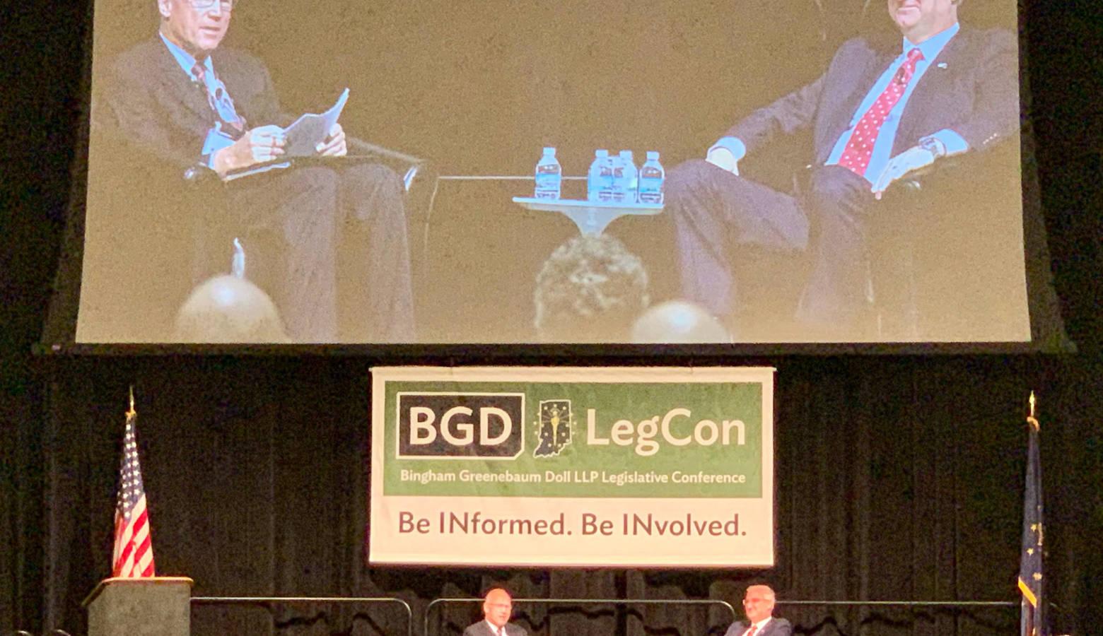 Gov. Eric Holcomb, right, speaks at the 2019 Bingham Greenebaum Doll Legislative Conference. (Brandon Smith/IPB News)