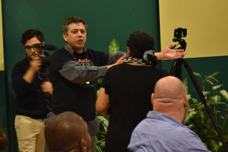 Igor Rodriguez, a protestor, disrupted an event for African American community leaders to show support for Mayor Pete Buttigieg. (Justin Hicks/IPB News)